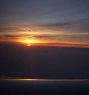 Sunrise from the Wing of a Plane